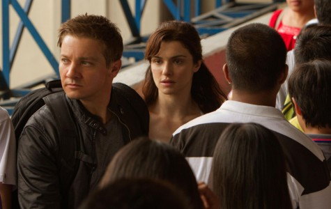 Actors Jeremy Renner (left) and Rachel Weisz run away from an enemy.  Universal Pictures