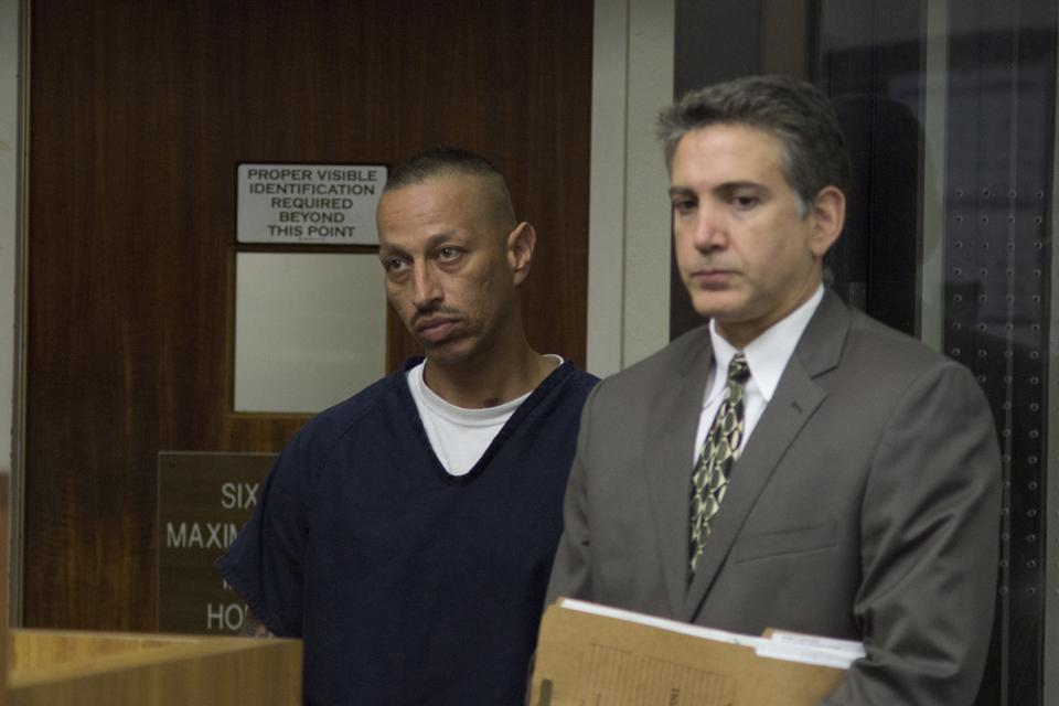 Armando Perez (left), a man charged with the murder of his estranged wife, City College student Diana Gonzalez, appeared before a judge on Aug. 27 for a bail hearing, beside his attorney Michael Garcia (right)