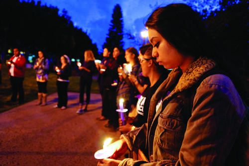 Sarah Guzman stands silently during City College's memorial for Diana Gonzalez in Gorton Quad on Oct. 11. Gonzalez was killed on campus Oct. 12 in 2010. Troy Orem, City Times