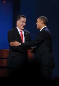 Republican presidential candidate Mitt Romney, left, and U.S. President Barack Obama shake hands before the first presidential debate at Denver University on Wednesday, October 3, 2012, in Denver, Colorado.