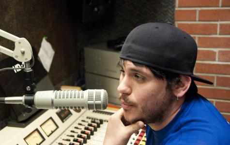 RTVC student Ken Smith prepares for a mock broadcast.- David L. Wells