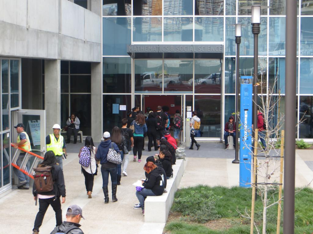 Students enter the Math and Social Sciences building for their first class, which has been open since Jan. 28. The building is located on C St and 16th St. -Ally Browne, City Times