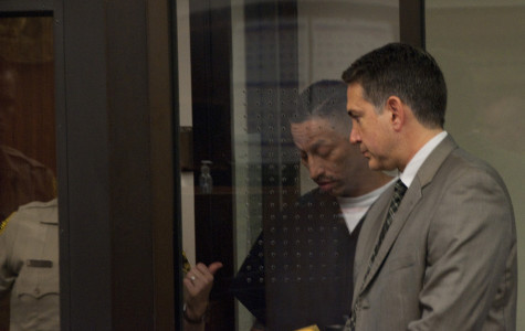 Perez (left) speaks with his attorney at his arraignment on Feb. 21 at the San Diego superior courthouse.- David L. Wells, City Times