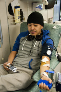 Biology major Jay Vue tries to relax as he donates, durring the Feb. 22 blood drive in the Gorton Quad. -David L. Wells, City Times