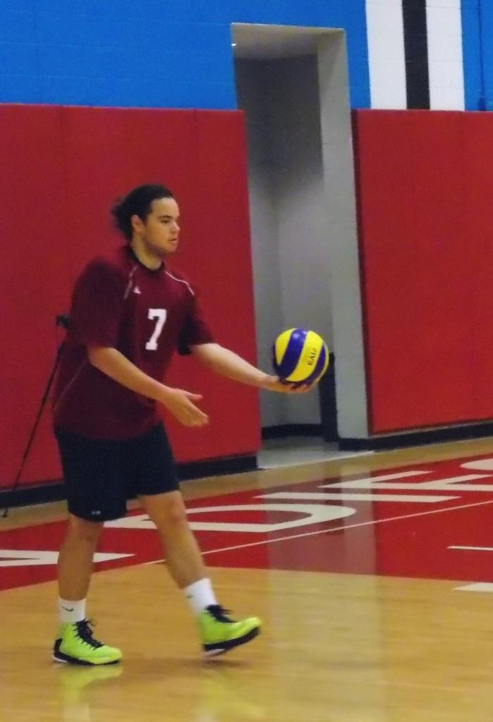 Knights volleyball player Rafael Garcia prepares to serve the ball during their home game against Mesa College on March 1, resulting in a loss of 0-3.
