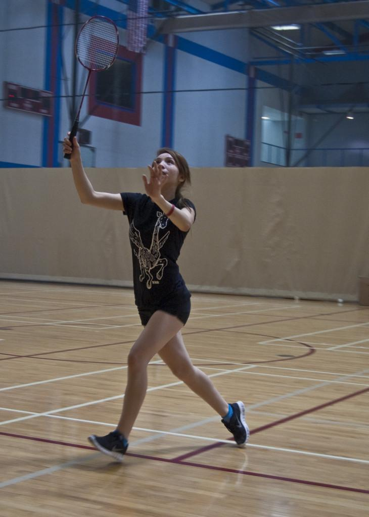 Player from the women's badminton team goes for the birdie during practice April 11 at the Harry West Gym. Audrey Brewer, City Times