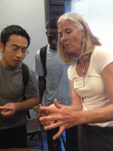 Program coordinator Annemarie Cox shows students a flint from a dig site in San Diego after her presentation on April 3.  Mariel Mostacero, City Times