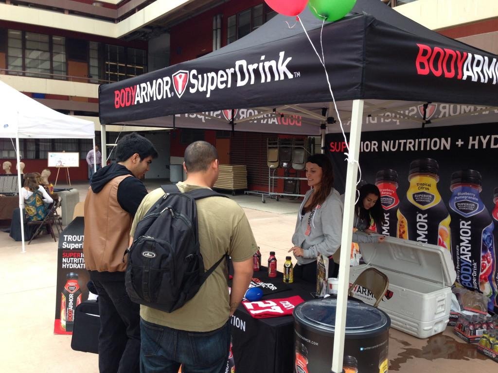 Students+receive+free+energy+drinks+at+the+Body+Armor+Super+Drink+stand+on+April+30.+Paul+Smoot%2C+City+Times