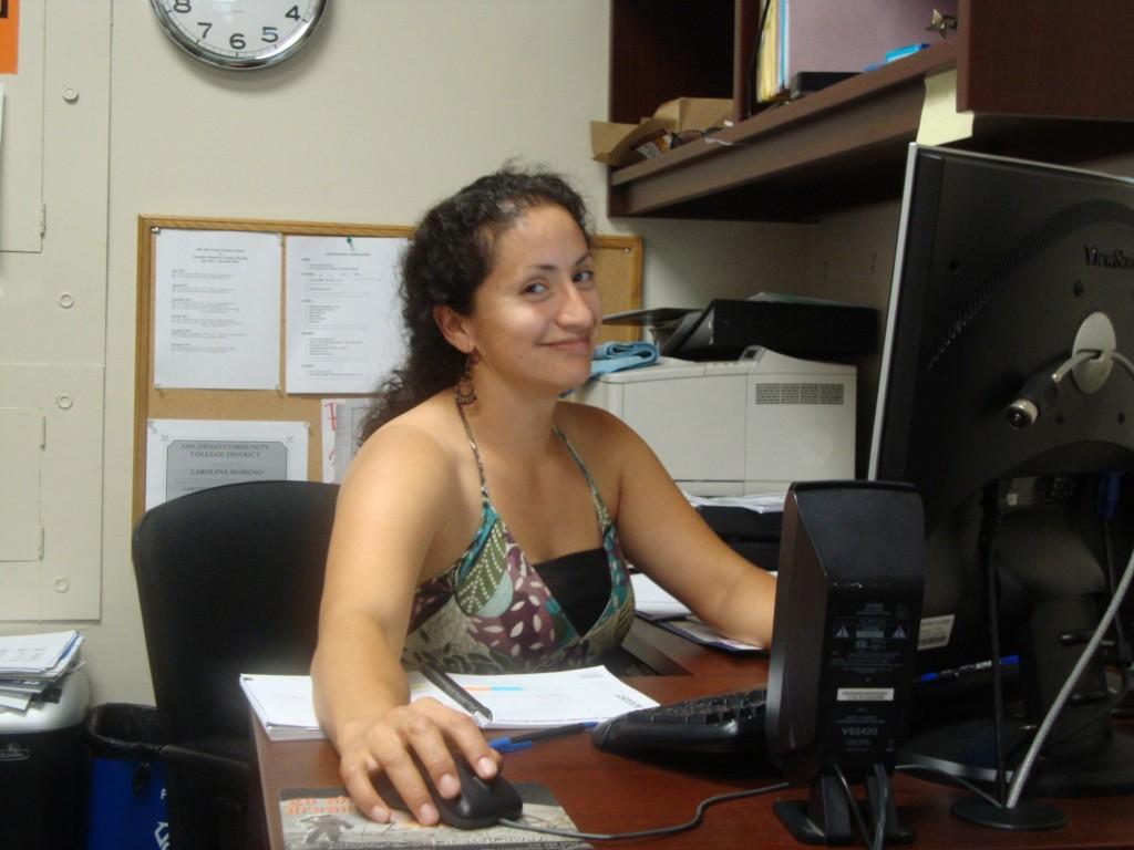 Carolina Moreno sitting at her desk. Chris Handloser, City Times.