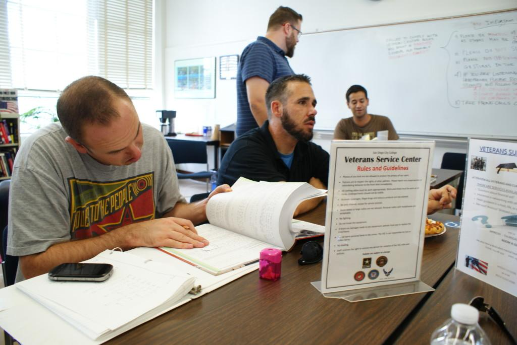 Peer counselors discuss some of the new services that will be available to student veterans this semester during a meeting at an open house event on Aug. 29. Torrey Spoerer, City Times.
