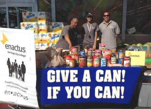 Enactus workers collecting canned food donations during their latest food drive. Official Facebook image.