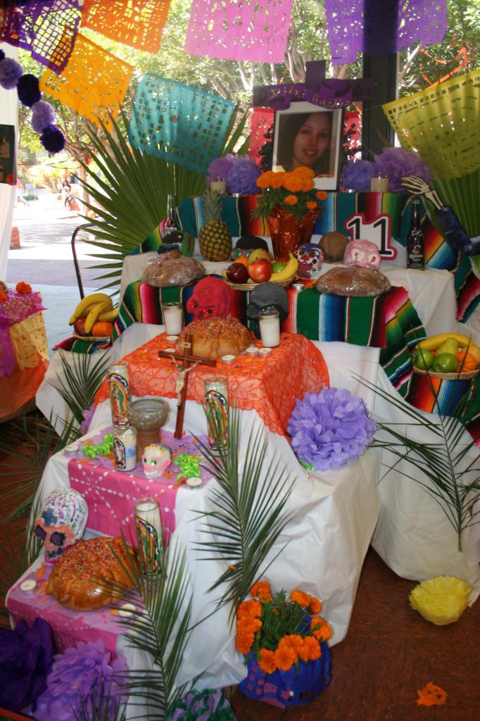 One+of+many+different+altars+that+were+on+display+in+the+cafeteria+to+commemorate+Dia+de+Los+Muertos.+Altars+and+offerings+are+created+to+honor+loved+ones+who+have+perished.+Michelle+Moran%2C+City+Times.