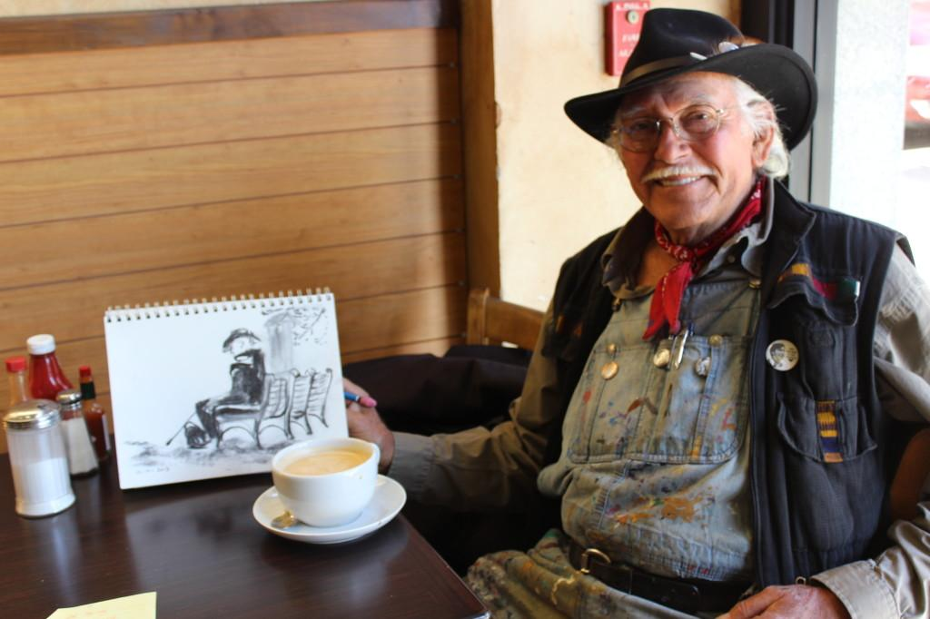 Salvador Torres works on his drawings at a local San Diego cafe in October.Photo credit: Andrew Hahn.