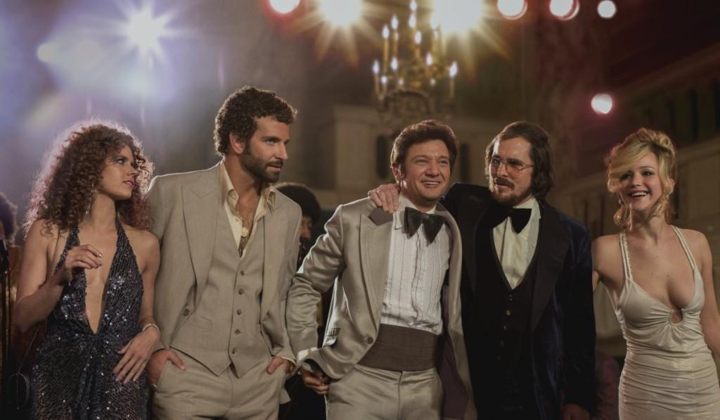 Amy Adams, Bradley Cooper, Jeremy Renner, Christian Bale and Jennifer Lawrence in American Hustle. Official image.