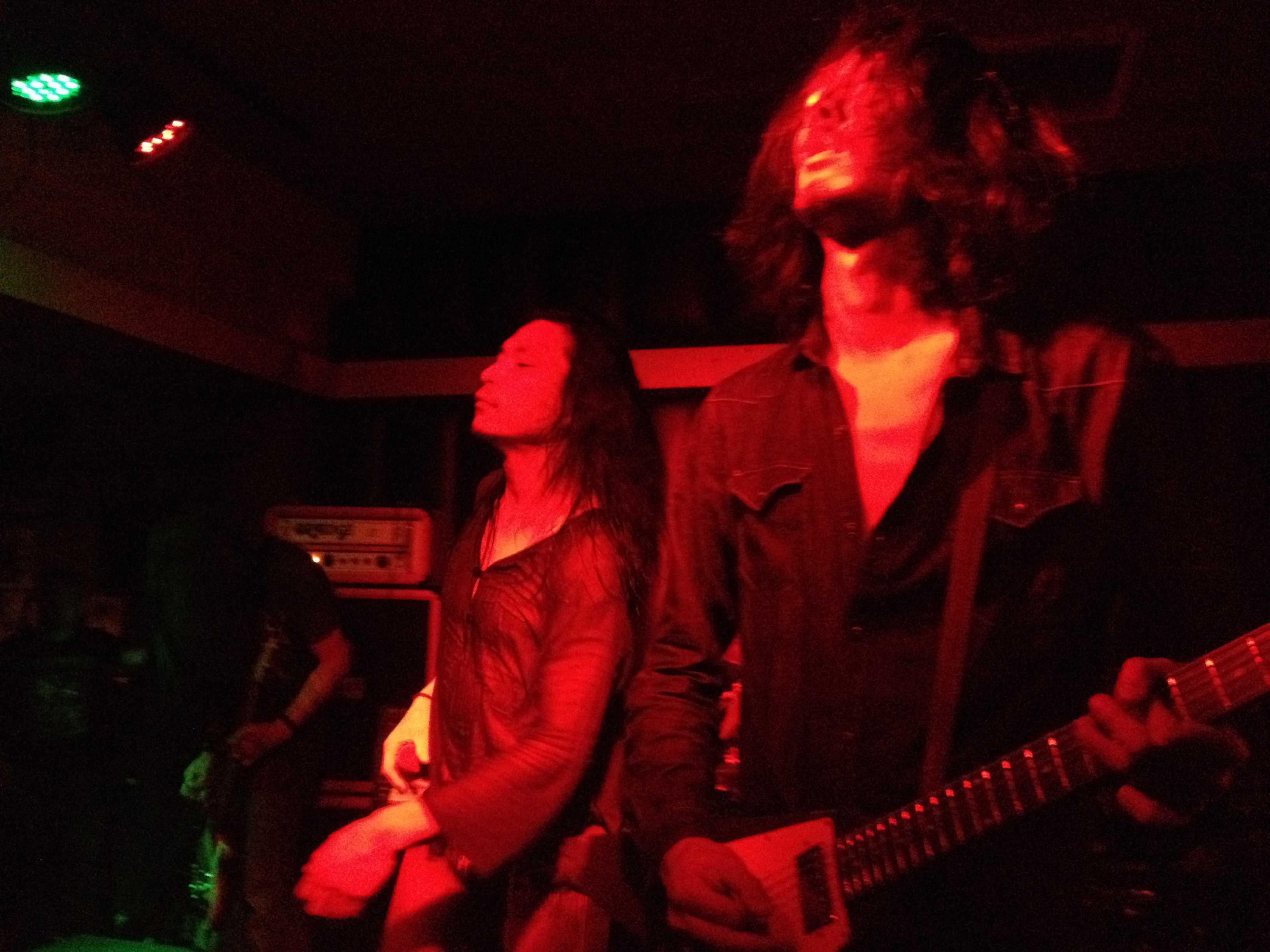 On the far left is bassist and founder Tatsu Mikami, center vocalist Hideki Fukasawa, right lead guitarist Ikuma Kawabe. From their Thanksgiving show at San Diego's Soda Bar. Jennifer Ovalle, City Times.