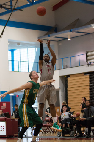 Freshman guard Mike Scott was awarded second team, all-conference honors averaging 13.2 points per game and a field goal percentage of 43.0 in 2013-14.  (Photo credit Xavier Besos)