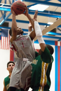 Point guard Martin Thomas skies over a Grossmont defender during the 76-69 win Feb. 14. (Photo courtesy of Xavier Besos)