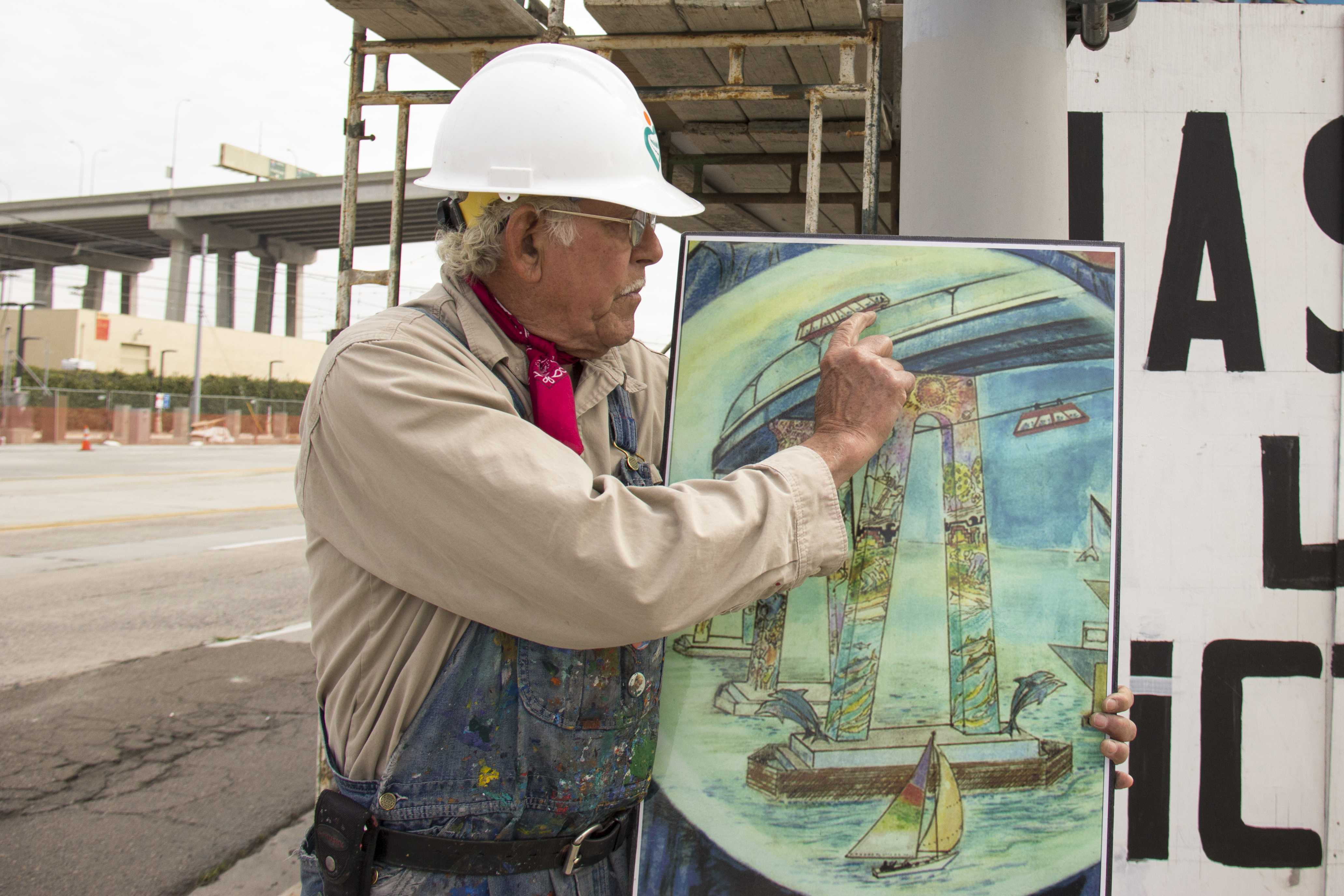 Local artist Salvador Roberto Torres displays his rendition for the completed mural project. Photo credit: Celia Jimenez