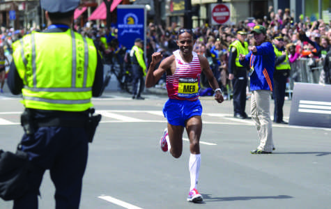 American Meb Keflezighi wins the 118th Boston Marathon, a year after deadly bombings, near the Marathon finish line in Boston, Monday, April 21, 2014. Keflezighi is the first American male to win since 1983. (Patrick Raycraft/Hartford Courant/MCT)