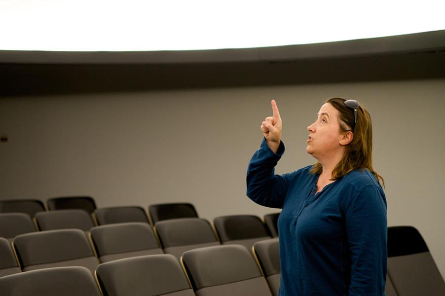 Dr. Lisa Will points out the the details of the domed projection screen used in Astronomy classes.