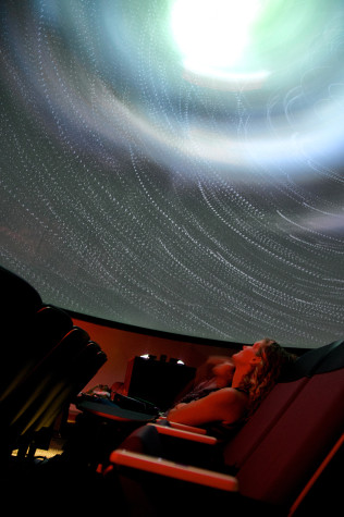 Guests experience the planetarium, a feature in the new Science Building. Photo credit: Troy Orem