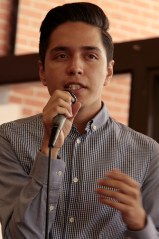 Adam Garcia addressing the City College audience at the election forum in the cafeteria on April 10. Photo credit: Celia Jimenez