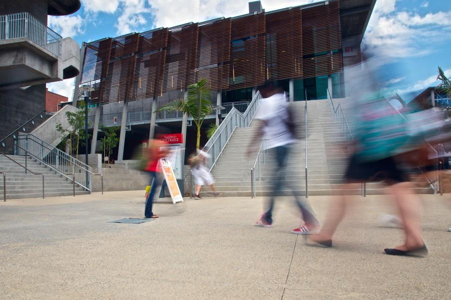 Students make their way to  classes in the new Arts and Humanities and Business Technology buildings, which opened Aug. 18. The buildings sport an efficient modern design and offer more space and better technologies. Photo credit: Troy Orem