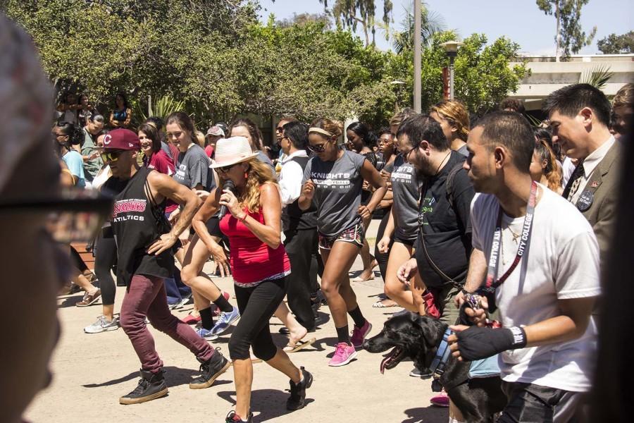 Professor Alicia Rincon teaching basic Salsa steps to the crowd.
