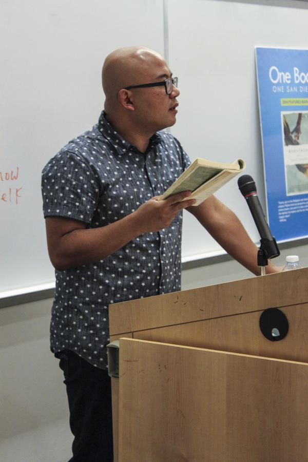 "Author Lysley Tenorio reads excerpts from his book ""Monstress,"" the 2014 One Book, One San Diego selection in V-101 during the Ninth Annual San Diego City College International Book Fair Oct. 16. Photo credit: Miguel Cid"