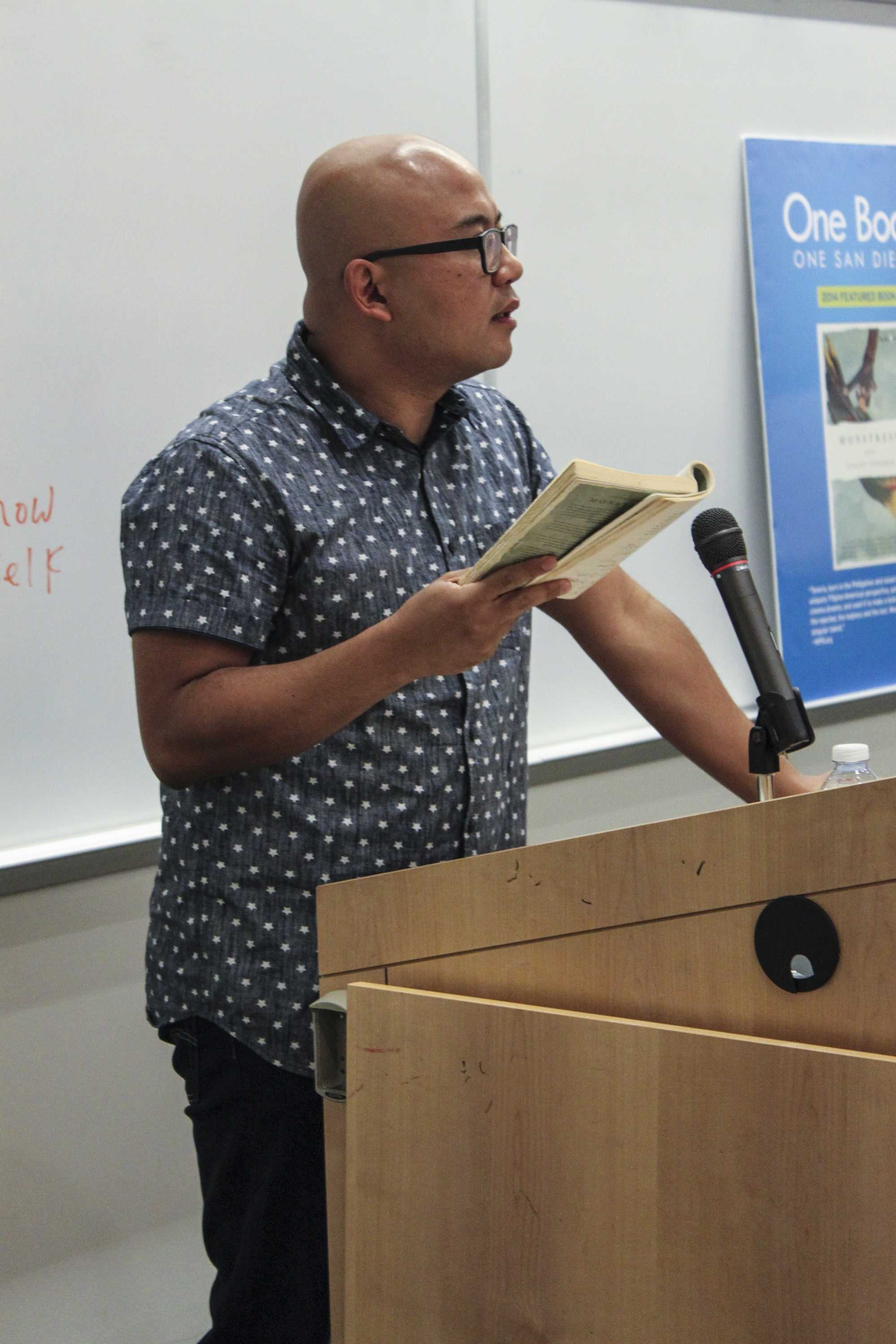 """Author Lysley Tenorio reads excerpts from his book """"Monstress,"""" the 2014 One Book, One San Diego selection in V-101 during the Ninth Annual San Diego City College International Book Fair Oct. 16. Photo credit: Miguel Cid"""