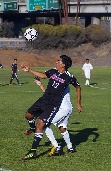 Sophomore forward Daniel Morales fights for possession of the ball against a Southwestern College defender on Oct. 24 where both teams tied 1-1. Photo credit: David Pradel
