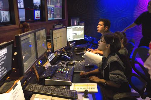Teresa Romero Medina (front) was directing the Newscene program on Sept. 5 at UT-TV with the help of Roxana Paul (middle) and Dallis Ontiveros (back). Photo credit: Celia Jimenez