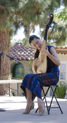 A woman performs traditional Chinese folks songs on an instrument called the pipa lute, representing the House of China in the Sept. 27 event held in Balboa Park. Photo credit: Richard Lomibao