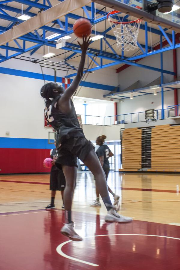 Sophomore forward Nyadoup Lam attacks the basket with a finger-roll lay-up during practice on Oct. 22. Photo credit: David Pradel
