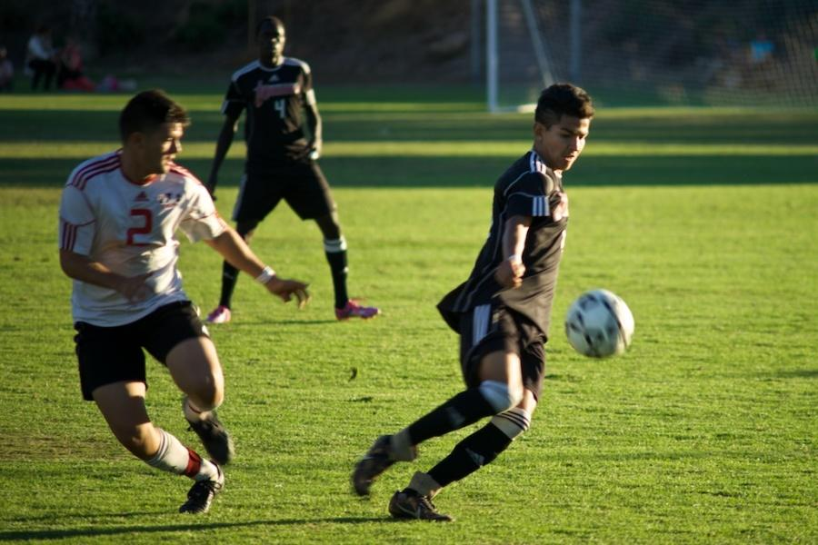 Knights defender Angel Garcia takes the ball from an opponent from Imperial Valley in the Nov. 7 home game. The Knights went on to win the game 2-0. Photo credit: Troy Orem