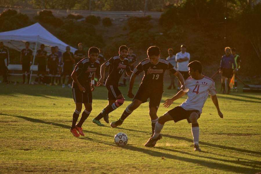 Knights sophomore forward Daniel Morales gains possession of the ball from Imperial Valley freshman defender Eduardo Galvan. City College won 2-0 on Nov. 7 at the SDCC Soccer Field. Photo credit: Troy Orem