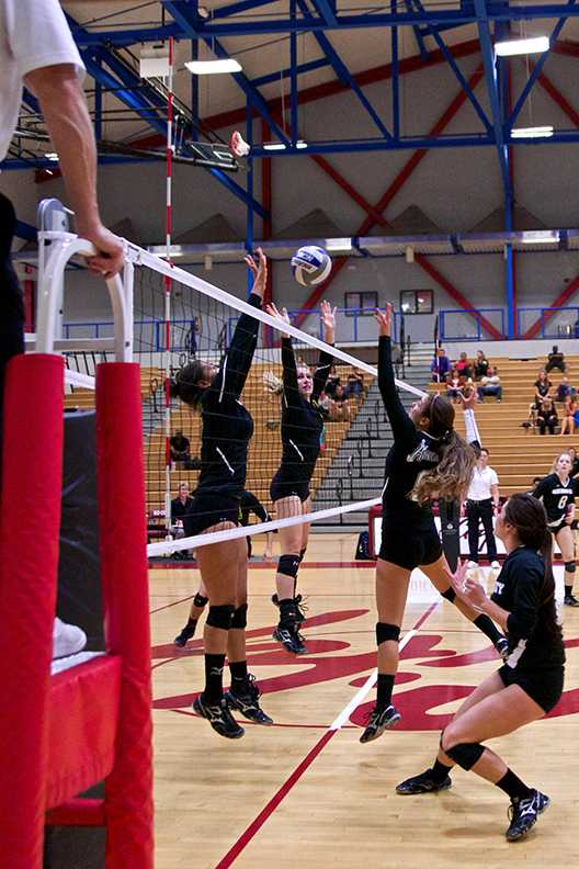 Outside hitter Michaela Keller returns the ball during the Nov. 7 home game against Grossmont. The Knights went on to lose the match 0-3 Photo credit: Troy Orem