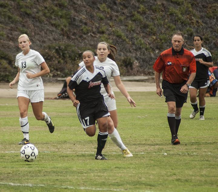 During a Knights attack, sophomore forward/midfielder Rebecca Garcia gets past the Jets defense on Oct. 31 at the SDCC Soccer Field where City College lost 3-0 against Miramar College. Photo credit: David Pradel
