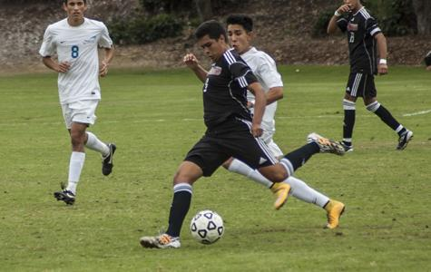While attacking the MiraCosta defense sophomore midfielder Daniel Herrera crosses the ball to the other side of the field on Oct. 31 at the SDCC Soccer Field where both teams tied 0-0. Photo credit: David Pradel