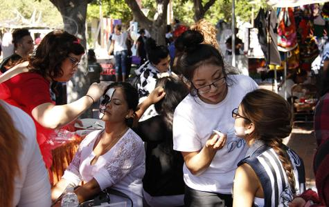 Carnival goers had the chance to get their face painted by members of the Cosmetology department at the ASG sponsored Halloween carnival Oct. 30 Photo credit: Celia Jimenez