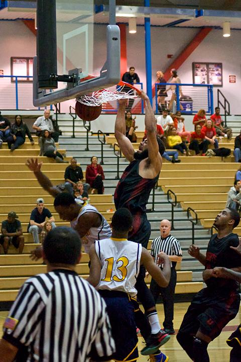 Sophomore guard Chris Burton dunks on a Barstow College player on Nov. 14 in the Harry West Gym. where Burton recorded a total of 39 points in the Knights 119-71 victory. Photo credit: Troy Orem