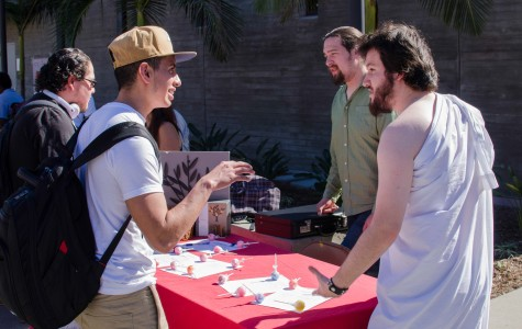 Edward Yannaccone (right), President of the Philosophy and Cameron Kiplinger, Vice President, look to recruit sophomore mechanical engineering student Luis Garcia (left) during Club Rush on Feb. 12. Photo credit: Richard Lomibao