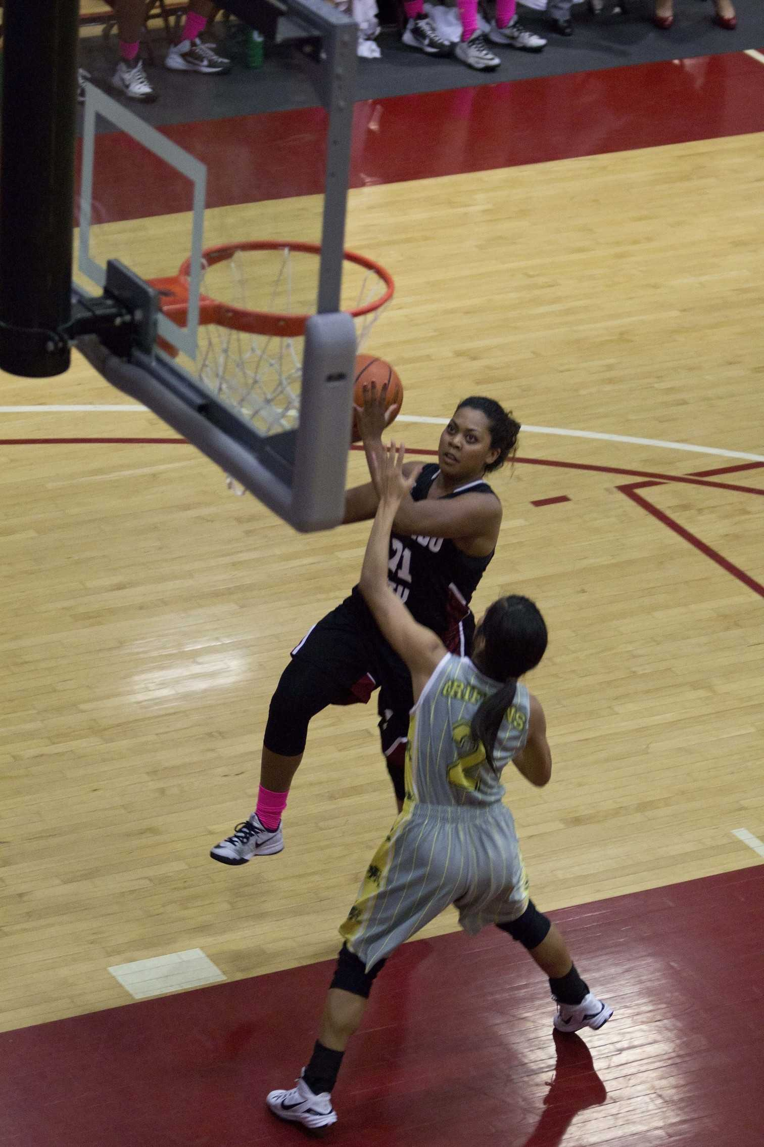 """In the team's last home game of the season, sophomore guard Daniesha Davis goes up for the layup during the second half as the Knights pulled out a 48-41 victory against Grossmont College on Feb. 18 and on """"sophomore night"""" at the Harry West Gym. Photo credit: David Pradel"""