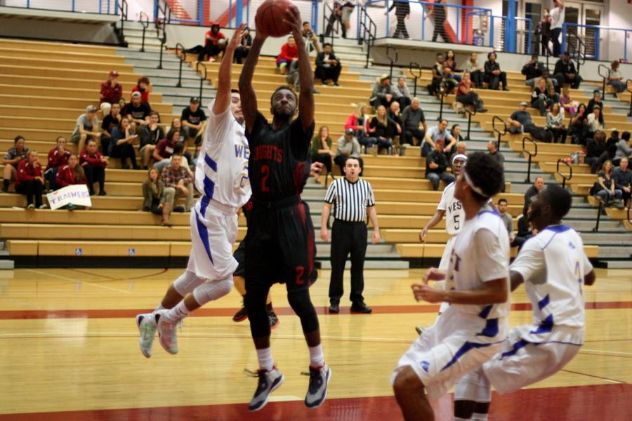 During the first half of the second round of the CCCAA Southern Regional Playoffs, freshman Marcus Brumsey goes up to get two points in the paint against West L.A. on Feb. 27 in the Harry West Gym. Photo credit: David Pradel