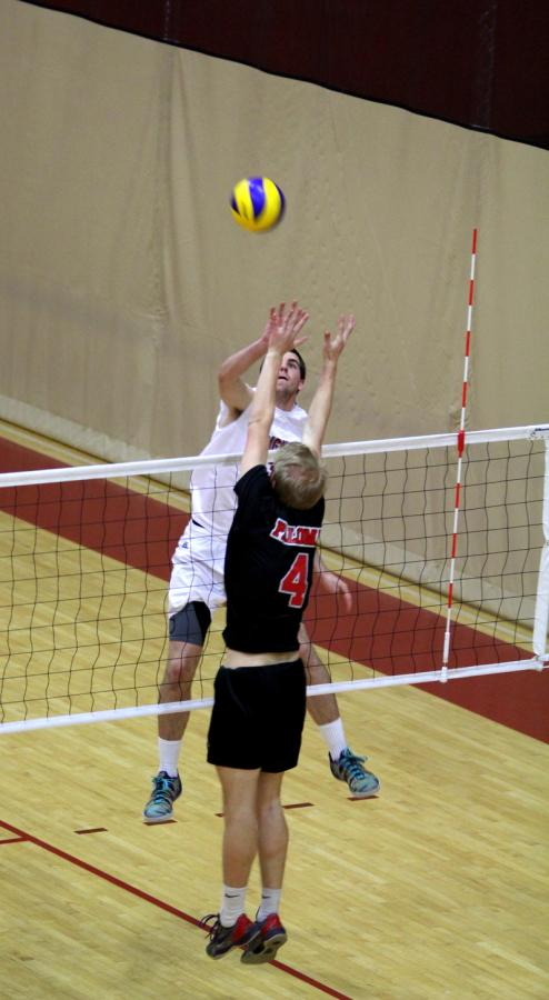 Freshman outside hitter Lucas Timm goes up to hit the ball against Palomar College freshman David McGuire during the third set of the match on March 13 at the Harry West Gym, where the Knights lost 3-1 against the Comets. Photo credit: David Pradel