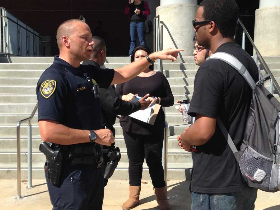 Officer J. Stone of the Campus Police department speaks with Umoja president Tony Givens about how to get in touch with officers during the Coffee With A Cop event March 12 in the BT/AH Quad. Photo credit: Angelica Wallingford