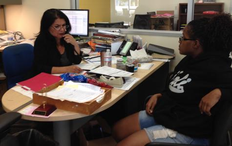 ASG Adviser Gail Rodriguez and ASG Senator Breona Harris discuss the upcoming Social Justice Conference on March 20 in the Student Affairs office in room M-200. Photo credit: Angelica Wallingford