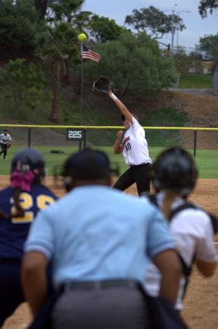 Mesa College freshman Sabrina Gonzalez hits the ball over San Diego City College freshman pitcher Micela Ross during the seventh inning of the game, where the Knights lost 7-2 against the Olympians on March 11 at the Betty Hock Softball Field. Photo credit: David Pradel