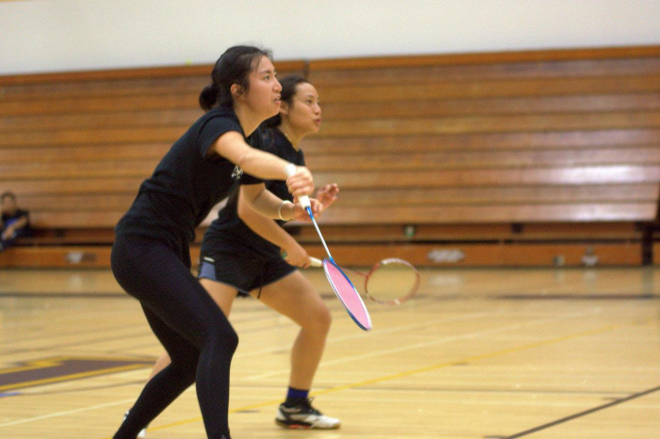Freshman Emerald Liu (front) and sophomore Gina Niph (back) both compete in the doubles round of the second annual Mesa College Badminton Tournament on March 20, where  Liu and Niph made it to the semifinals of the doubles bracket. Photo credit: David Pradel