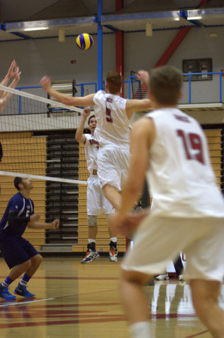 During the home opening match on Feb. 13, freshman middle blocker Zach Kramer goes up to send a hard hitting kill to the defense of El Camino College in the Harry West Gym. Photo credit: David Pradel